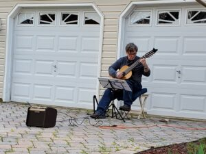 George performing at a Driveway Mini-Concert