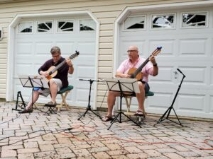 George playing with his student John at a recent Driveway Mini-Concert